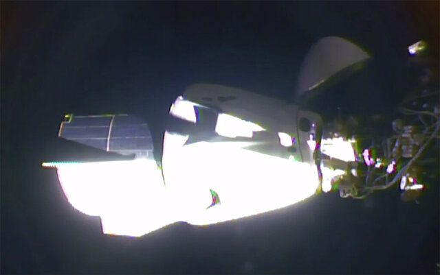 In this image taken from NASA TV video, the SpaceX Dragon crew capsule, with NASA astronauts Doug Hurley and Robert Behnken aboard, docks with the International Space Station Sunday, May 31, 2020. It was the first time a privately built and owned spacecraft carried astronauts to the orbiting lab in its nearly 20 years.   (NASA TV via AP)