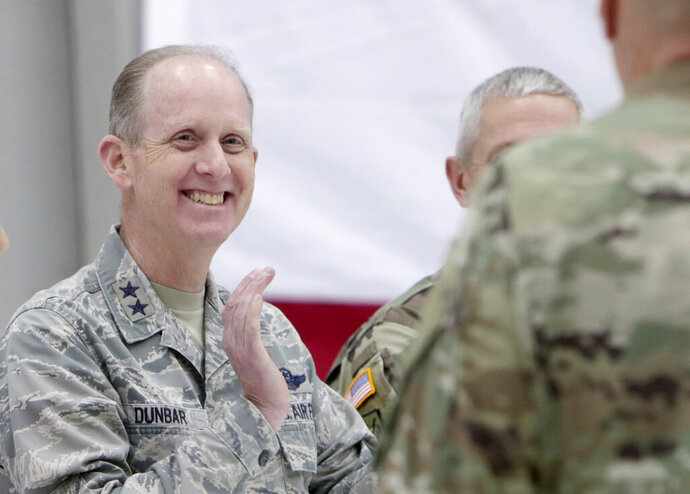 """In a Jan. 25, 2018 file photo, Maj. Gen. Don Dunbar welcomes home approximately 75 Wisconsin Army National Guard soldiers from the 1st Battalion,147th Aviation during a ceremony at the Army Aviation Support Facility in Madison, Wis. Dunbar says all recommendations made following an investigation into multiple reports of sexual assault and harassment will be implemented. Maj. Gen. Don Dunbar says in a statement Monday, Dec. 9, 2019 that he was briefed on results of the investigation on Saturday. Gov. Tony Evers and U.S. Sen. Tammy Baldwin requested the probe by the National Guard Bureau's Office of Complex Investigations. Dunbar says his team is in the process of reviewing the report and """"we intend to implement all of the recommendations.""""  (Amber Arnold/Wisconsin State Journal via AP)"""