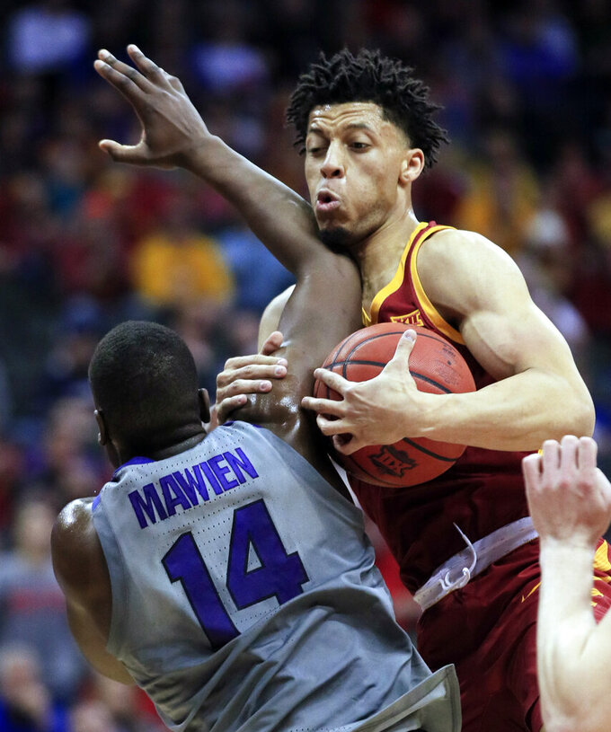 Iowa State guard Lindell Wigginton, right, pulls in a rebound against Kansas State forward Makol Mawien (14) during the first half of an NCAA college basketball game in the semifinals of the Big 12 conference tournament in Kansas City, Mo., Friday, March 15, 2019. (AP Photo/Orlin Wagner)