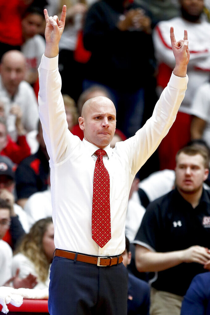 St. Francis Pa. head coach Rob Krimmel signals to his team during the second half of an NCAA college basketball game against Fairleigh Dickinson for the championship of the Northeast Conference men's tournament, Tuesday, March 12, 2019, in Pittsburgh. Fairleigh Dickinson won 85-76. (AP Photo/Keith Srakocic)