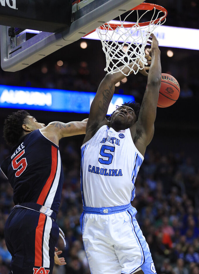 Auburn's Chuma Okeke (5), left, knocks the ball away from North Carolina's Nassir Little during the second half of a men's NCAA tournament college basketball Midwest Regional semifinal game Friday, March 29, 2019, in Kansas City, Mo. (AP Photo/Orlin Wagner)
