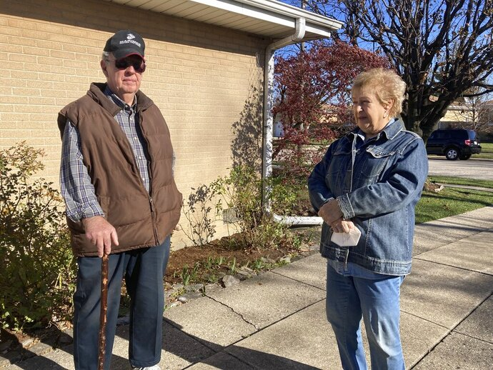 Dan and Barbara Donovan of Niles say they were targeted by intruders when a man claiming to be a ComEd employee came to their home, Tuesday, Nov. 17, 2020 in Niles, Ill. Donovan, an 81-year-old former Marine from suburban Chicago used his grandfather's antique Irish walking stick to chase off three burglars and deliver one a thump in the head for his trouble.(Jennifer Johnson/Chicago Tribune via AP)
