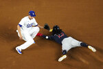 Atlanta Braves' Ronald Acuna Jr. is safe at second past Los Angeles Dodgers shortstop Corey Seager after a double during the first inning in Game 7 of a baseball National League Championship Series Sunday, Oct. 18, 2020, in Arlington, Texas. (AP Photo/David J. Phillip)