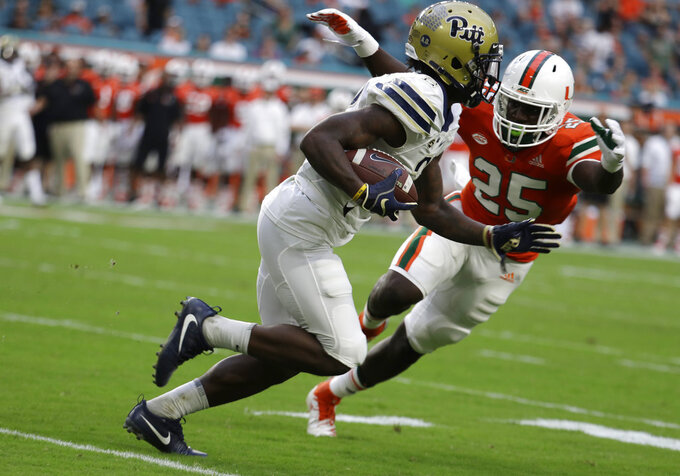 Pittsburgh wide receiver Maurice Ffrench (2) runs past Miami defensive back Derrick Smith (25) during the first half of an NCAA college football game, Saturday, Nov. 24, 2018, in Miami Gardens, Fla. (AP Photo/Lynne Sladky)