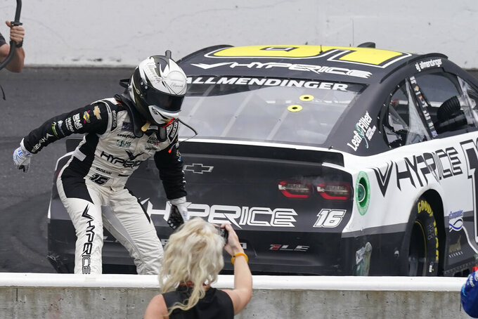 AJ Allmendinger celebrates after winning a NASCAR Series auto race at Indianapolis Motor Speedway, Sunday, Aug. 15, 2021, in Indianapolis. (AP Photo/Darron Cummings)