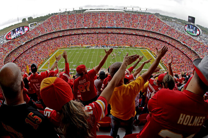 Fans celebrate a Kansas City Chiefs first down during the first half of an NFL football game against the Baltimore Ravens, Sunday, Sept. 22, 2019, in Kansas City, Mo. (AP Photo/Charlie Riedel)