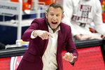 FILE - Alabama head coach Nate Oats directs his players against LSU during the first half of the championship game at the NCAA college basketball Southeastern Conference Tournament in Nashville, in this Sunday, March 14, 2021, file photo. Nobody will get a lump in their throat or start sizing up glass slippers for programs like these — Alabama, Illinois, Baylor.  They're not underdogs. They're hardly unknown. What they are is a group of new teams with well-recognized names in the NCAA Tournament, and they're hoping to keep making life hard on the programs that have long had a stranglehold on March.(AP Photo/Mark Humphrey, File)