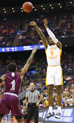 Tennessee's Jordan Bone (0) shoots over Colgate's Jordan Burns (1) in the first half during a first round men's college basketball game in the NCAA Tournament in Columbus, Ohio, Friday, March 22, 2019. (AP Photo/Paul Vernon)