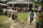 People whose names were left out in the National Register of Citizens (NRC) draft stand in a queue to collect forms to file appeals in Mayong, 45 kilometers (28 miles) east of Gauhati, India, Friday, Aug. 10, 2018. A draft list of citizens in Assam, released in July, put nearly 4 million people on edge to prove their Indian nationality. Nativist anger churns through Assam, just across the border from Bangladesh, with many believing the state is overrun with illegal migrants. (AP Photo/Anupam Nath)