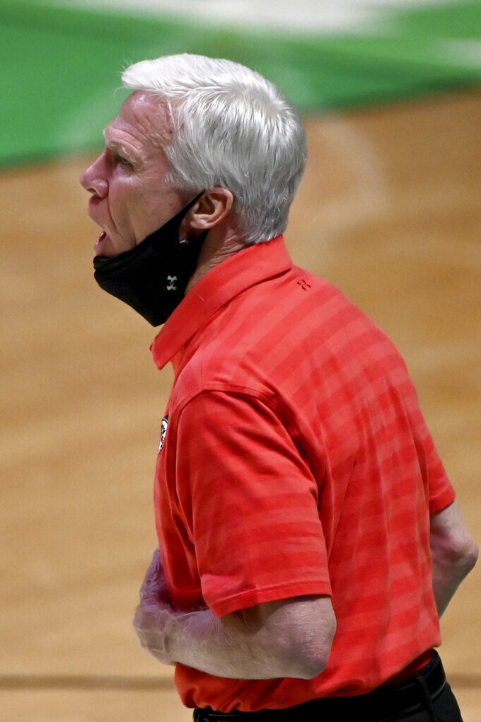 Davidson head coach Bob McKillop gives instructions to his team in the second half of an NCAA college basketball game in the first round of the NIT, Thursday, March 18, 2021, in Denton, Texas. North Carolina State won 75-61. (AP Photo/Matt Strasen)