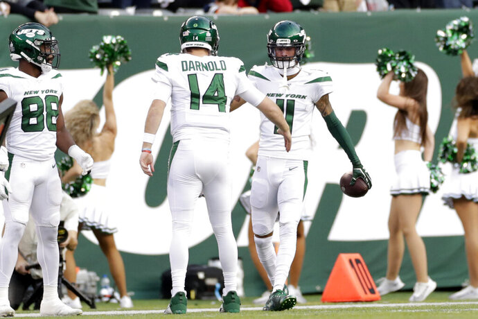 New York Jets quarterback Sam Darnold (14) celebrates a touchdown with Robby Anderson (11) during the first half of an NFL football game against the Dallas Cowboys, Sunday, Oct. 13, 2019, in East Rutherford, N.J. (AP Photo/Adam Hunger)