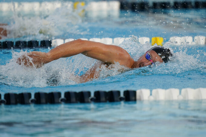 Jordan Wilimovsky competes in the men's 800 freestyle at the U.S. Open swimming championships Thursday, Nov. 12, 2020, in Irvine, Calif. (AP Photo/Ashley Landis)