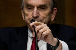 State Department Special Representative for Venezuela Ambassador Elliott Abrams prepares to testify at a Senate Foreign Relations Committee hearing on Capitol Hill in Washington, Tuesday, Aug. 4, 2020. (AP Photo/Andrew Harnik)