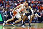 Syracuse guard Buddy Boeheim, left, is defended by Duke guard Jordan Goldwire during the first half of an NCAA college basketball game in Syracuse, N.Y., Saturday, Feb. 1, 2020. (AP Photo/Adrian Kraus)