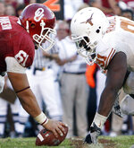 FILE - In this Oct. 2, 2010, file photo, Texas defensive tackle Kheeston Randall (91) and Oklahoma offensive lineman Ben Habern (61) face off at the line of scrimmage during an NCAA college football game at the Cotton Bowl in Dallas. No. 5 Oklahoma and No. 9 Texas are playing in a rare Red River rivalry rematch in the Big 12 championship game on Saturday. It is the first time in 115 years that the border state rivals will play twice in the same season.  (AP Photo/LM Otero, File)