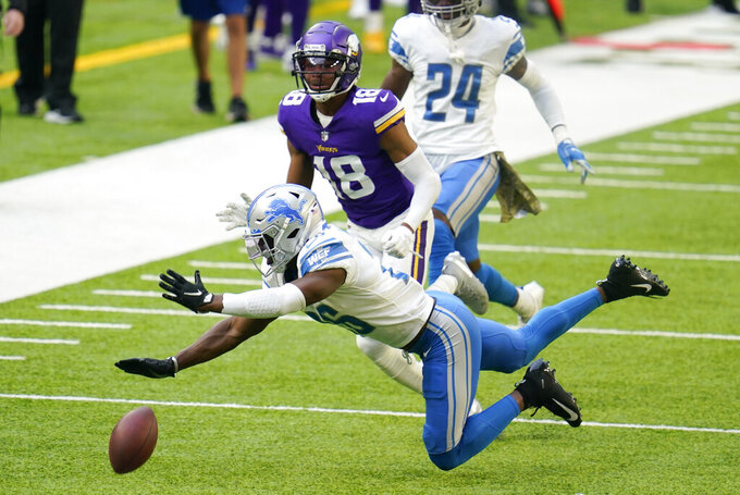 Detroit Lions safety Duron Harmon breaks up a pass intended for Minnesota Vikings wide receiver Justin Jefferson (18) during the second half of an NFL football game, Sunday, Nov. 8, 2020, in Minneapolis. (AP Photo/Jim Mone)