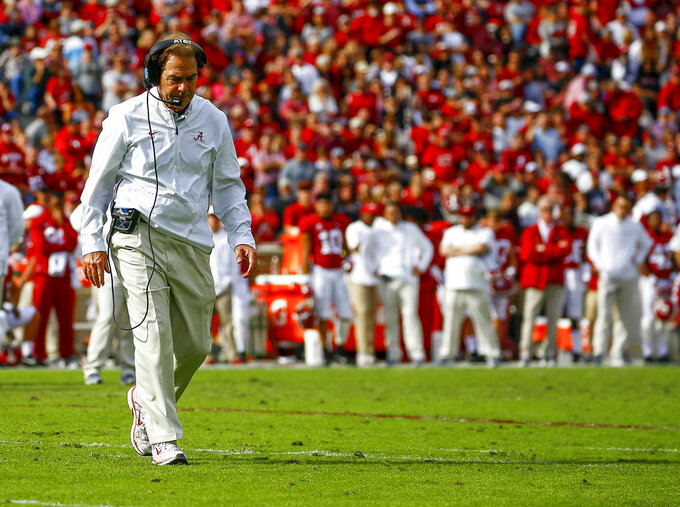 Alabama head coach Nick Saban walks across the field to check on running back Damien Harris (34) during the second half of an NCAA college football game against the Citadel, Saturday, Nov. 17, 2018, in Tuscaloosa, Ala. (AP Photo/Butch Dill)