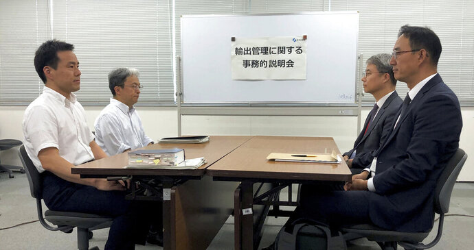 Jeon Chansu, right, manager of South Korean Trade Security Section at Ministry of Industry, Trade and Resources, and Jun Iwamatsu, left, director of Japanese Trade Control Policy Division, Trade Control Department, meet to discuss Japan's tightening of controls on high-tech exports to South Korea, in Tokyo, Japan, Friday, July 12, 2019. (Kim Byung-kyun/Yonhap via AP)