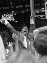 FILE - In this early Tuesday, April 5, 1983, file photo, North Carolina State coach Jim Valvano waves the net in victory after defeating Houston in the NCAA Final Four championship game in Albuquerque, N.M.  Lorenzo Charles' dunk shot with one second remaining fulfilled North Carolina State's impossible dream, giving the Wolfpack a 54-52 victory over top-ranked Houston. (AP Photo/Leonard Ignelzi, File)