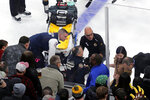 Medical workers attend to Ottawa Senators right wing Scott Sabourin, who was injured on a play with Boston Bruins right wing David Backes, during the first period of an NHL hockey game in Boston, Saturday, Nov. 2, 2019. (AP Photo/Charles Krupa)