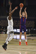 Clemson's Hunter Tyson shoots over Wake Forest's Isaiah Mucius during an NCAA college basketball game Wednesday, Feb. 24, 2021, in Winston-Salem, N.C. (Walt Unks/The Winston-Salem Journal via AP, Pool)