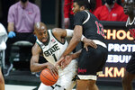 Michigan State guard Joshua Langford (1) drives on Nebraska forward Derrick Walker (13) in the first half of an NCAA college basketball game in East Lansing, Mich., Saturday, Feb. 6, 2021. (AP Photo/Paul Sancya)