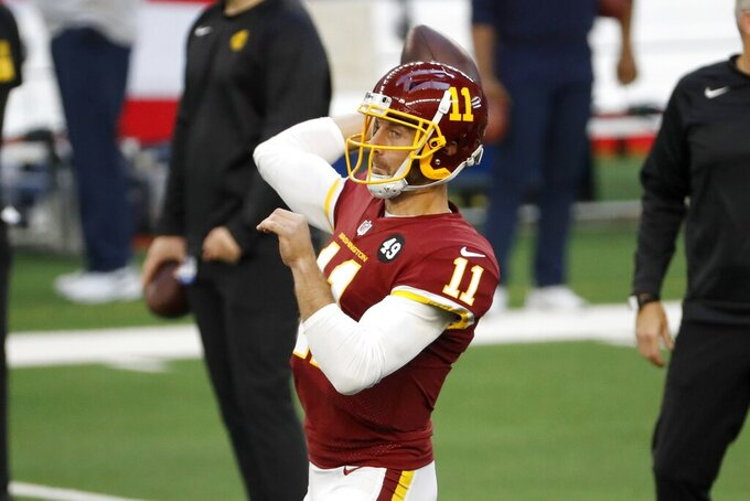 Washington Football Team quarterback Alex Smith warms up before an NFL football game against the Dallas Cowboys in Arlington, Texas, Thursday, Nov. 26, 2020. (AP Photo/Roger Steinman)