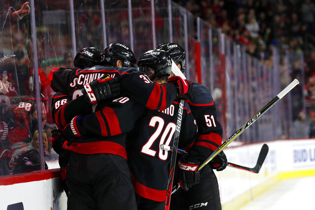 The Carolina Hurricanes celebrate a goal by Andrei Svechnikov during the second period of an NHL hockey game against the New Jersey Devils in Raleigh, N.C., Friday, Feb. 14, 2020. (AP Photo/Karl B DeBlaker)