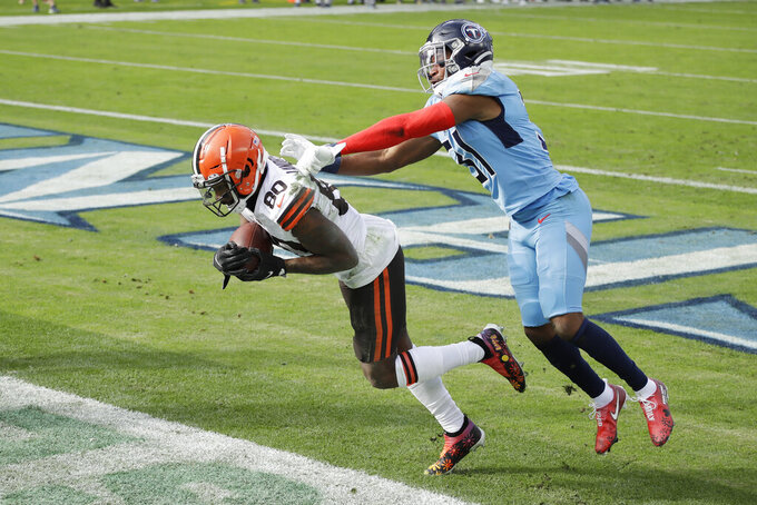 Cleveland Browns wide receiver Jarvis Landry (80) catches a touchdown pass ahead of Tennessee Titans free safety Kevin Byard (31) in the first half of an NFL football game Sunday, Dec. 6, 2020, in Nashville, Tenn. (AP Photo/Ben Margot)