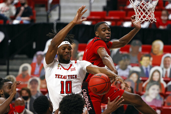 Incarnate Word's Bradley Akhile (1) fouls Texas Tech's Tyreek Smith (10) as he tries to shoot the ball during the first half of an NCAA college basketball game Tuesday, Dec. 29, 2020, in Lubbock, Texas. (AP Photo/Brad Tollefson)