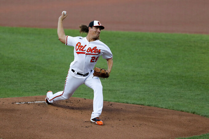 Baltimore Orioles starting pitcher Asher Wojciechowski throws to the New York Yankees during the first inning of a baseball game, Wednesday, July 29, 2020, in Baltimore. (AP Photo/Julio Cortez)