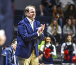 Mississippi coach Kermit Davis applauds during the team's NCAA college basketball game against Seattle on Tuesday, Nov. 19, 2019, in Oxford, Miss. (Bruce Newman/The Oxford Eagle via AP)