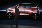Kunio Nakaguro, executive vice president for Nissan Motor Corp., speaks during Nissan's presentation of the media preview of the Tokyo Motor Show Wednesday, Oct. 23, 2019, in Tokyo. (AP Photo/Kiichiro Sato)