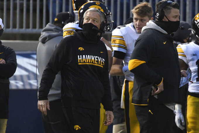 Iowa head coach Kirk Ferentz looks at the scoreboard during the first quarter of an NCAA college football game against Penn State in State College, Pa., on Saturday, Nov. 21, 2020. (AP Photo/Barry Reeger)