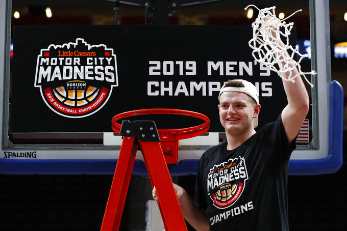 Northern Kentucky's Drew McDonald holds up the net after the team's 77-66 win against Wright State in an NCAA college basketball game for the Horizon League men's tournament championship in Detroit, Tuesday, March 12, 2019. (AP Photo/Paul Sancya)