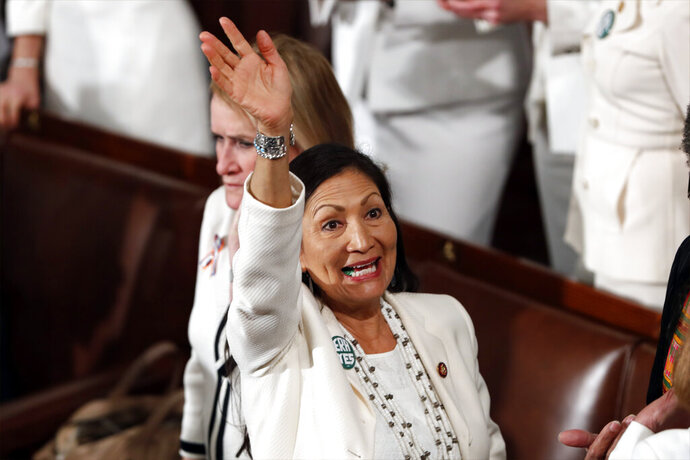 FILE - In this Feb. 5, 2019, file photo, U.S. Rep. Debra Haaland, D-N.M., arrives before President Donald Trump delivers his State of the Union address to a joint session of Congress on Capitol Hill in Washington. Democratic presidential hopeful Elizabeth Warren announced Friday, Nov. 22, 2019 she has named Haaland, U.S. Reps. Ayanna Pressley, D-Mass., and Katie Porter, D-Calif., as her campaign co-chairs. (AP Photo/J. Scott Applewhite, File)