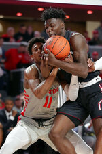 Houston guard Nate Hinton (11) collides with Temple forward De'Vondre Perry (22) as he attempts a steal during the first half of an NCAA college basketball game Thursday, Jan. 31, 2019, in Houston. (AP Photo/Michael Wyke)