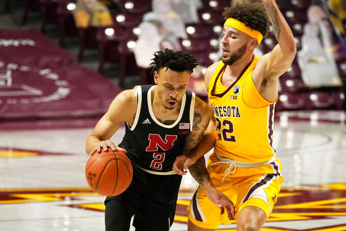 Nebraska's Trey McGowens (2) drives around Minnesota's Gabe Kalscheur (22) in the second half of an NCAA college basketball game, Monday, Feb. 8, 2021, in Minneapolis.  (AP Photo/Jim Mone)