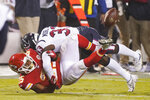 Kansas City Chiefs running back Clyde Edwards-Helaire (25) loses the ball as he is hit by Houston Texans safety A.J. Moore Jr. (33) in the second half of an NFL football game Thursday, Sept. 10, 2020, in Kansas City, Mo. (AP Photo/Charlie Riedel)