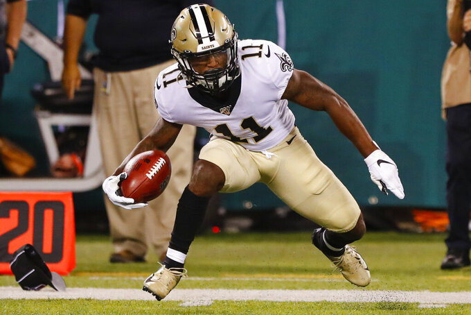 FILE - In this Aug. 24, 2019, file photo, New Orleans Saints' Deonte Harris (11) runs during the first half of a preseason NFL football game against the New York Jets, in East Rutherford, N.J. Saints rookie Deonte Harris wanted to believe his record-setting career as a return man at the Division II level of college football would translate in the NFL. It sure looked that way during the preseason, particularly on his 78-yard punt return touchdown against the New York Jets. Now the 5-foot-6, 170-pound Harris, who left college as NCAA's all-time leader in combined kick and punt returns for touchdowns with 14, is set to make his NFL debut before a national TV audience against the Houston Texans on Monday night. (AP Photo/Noah K. Murray, File)
