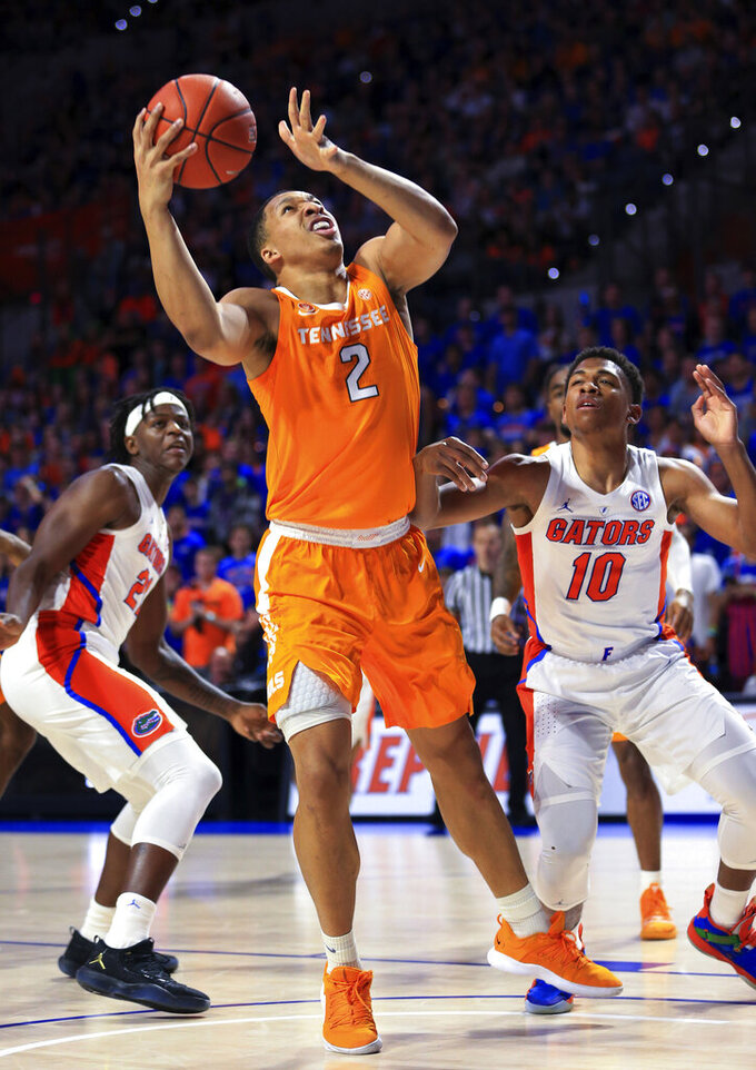 Tennessee forward Grant Williams (2) shoots next to Florida guard Noah Locke (10) during the first half of an NCAA college basketball game Saturday, Jan. 12, 2019, in Gainesville, Fla. (AP Photo/Matt Stamey)