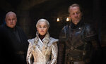 This image released by HBO shows from left Conleth Hill, Emilia Clarke, Iain Glen in a scene from