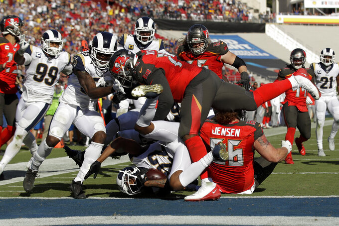 Los Angeles Rams cornerback Marcus Peters scores on a interception against the Tampa Bay Buccaneers during the second of an NFL football game Sunday, Sept. 29, 2019, in Los Angeles. (AP Photo/Marcio Jose Sanchez)