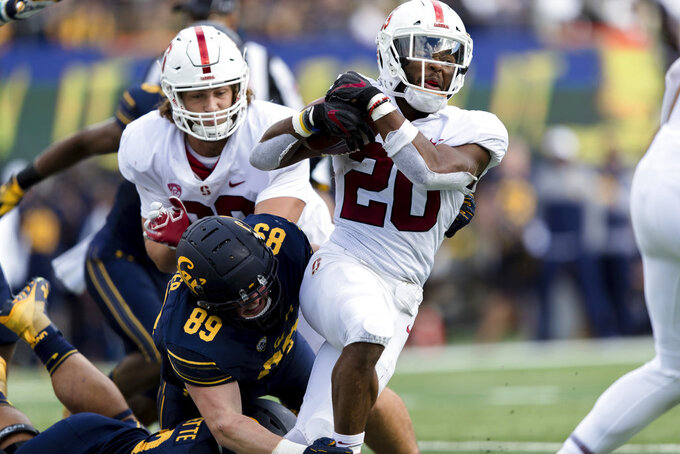 Stanford running back Bryce Love (20) runs the ball as California linebacker Evan Weaver (89) defends in the second quarter of a football game in Berkeley, Calif., Saturday, Dec. 1, 2018. (AP Photo/John Hefti)