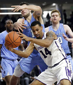 Northwestern guard Ryan Taylor (14) battles for a rebound against Columbia guard Gabe Stefanini (15) during the second half of an NCAA college basketball game Sunday, Dec. 30, 2018, in Evanston, Ill. Northwestern won 75-54. (AP Photo/Nam Y. Huh)