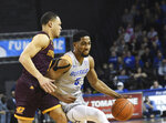 Buffalo's C.J. Massinburg, right, drives past Central Michigan's Larry Austin, Jr., during an NCAA college basketball game in Buffalo, N.Y., Saturday, Feb. 9, 2019. (AP Photo/Heather Ainsworth)