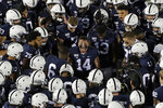 Penn State quarterback Sean Clifford (14) fires up teammates before an NCAA college football game against Michigan in State College, Pa., Saturday, Oct. 19, 2019. (AP Photo/Gene J. Puskar)