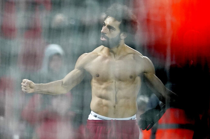 Liverpool's Mohamed Salah celebrates scoring his side's second goal during the English Premier League soccer match between Liverpool and Manchester United at Anfield Stadium in Liverpool, Sunday, Jan. 19, 2020.(AP Photo/Jon Super)