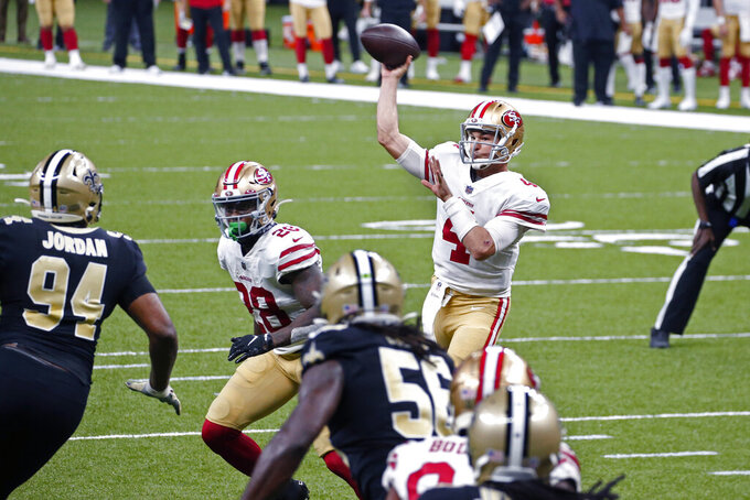 San Francisco 49ers quarterback Nick Mullens (4) throws a touchdown pass to wide receiver Brandon Aiyuk in the first half of an NFL football game against the New Orleans Saints in New Orleans, Sunday, Nov. 15, 2020. (AP Photo/Butch Dill)