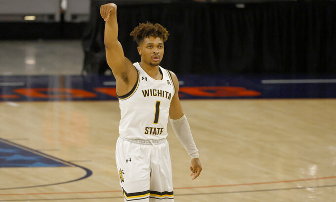 Wichita State guard Tyson Etienne (1) reacts after a 3-point shot against Cincinnati during the first half of an NCAA college basketball game in the semifinal round of the American Athletic Conference men's tournament Saturday, March 13, 2021, in Fort Worth, Texas. (AP Photo/Ron Jenkins)